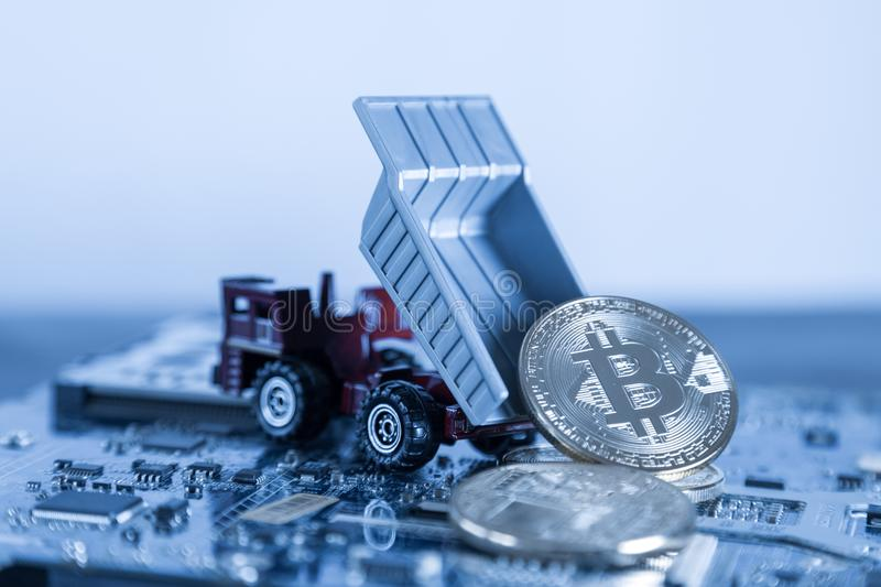 Macro Dump Truck On Blue Computer Motherboard Background. Dumpi. Ng Silver Bitcoin Mining Concept stock photo