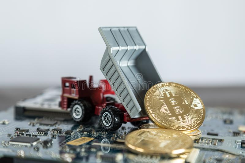 Macro Dump Truck On Computer Motherboard. Dumping Gold Bitcoin. Mining Concept stock images
