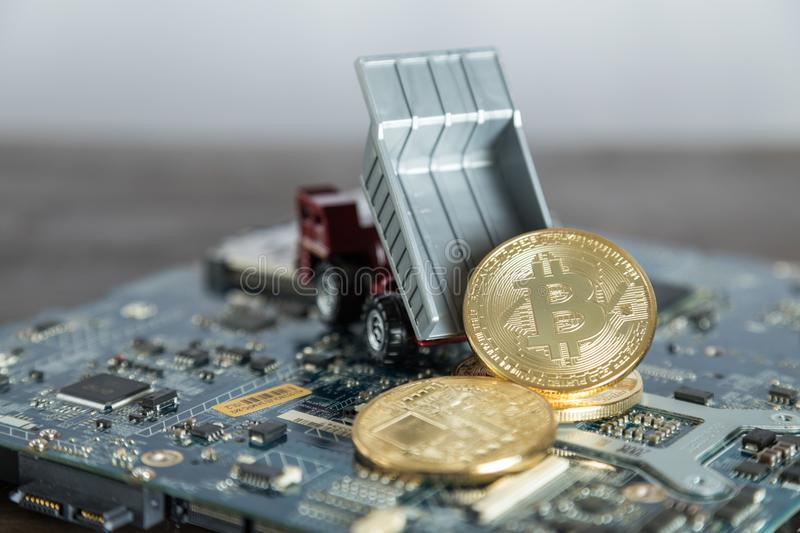 Macro Dump Truck On Computer Motherboard. Dumping Gold Bitcoin. Mining Concept royalty free stock images