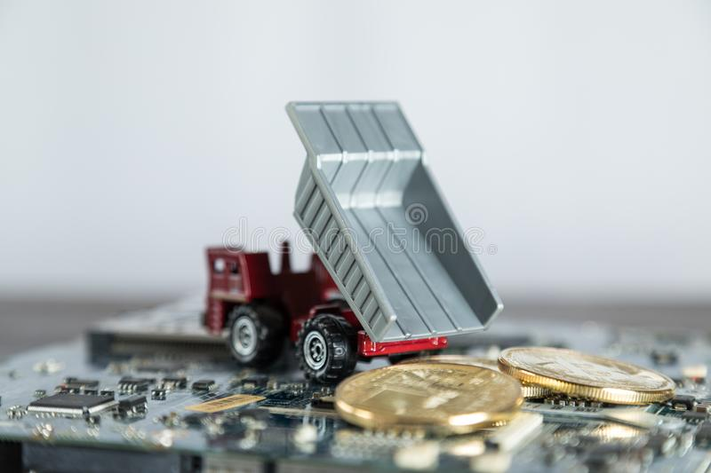 Macro Dump Truck On Computer Motherboard. Dumping Gold Bitcoin. Mining Concept royalty free stock image