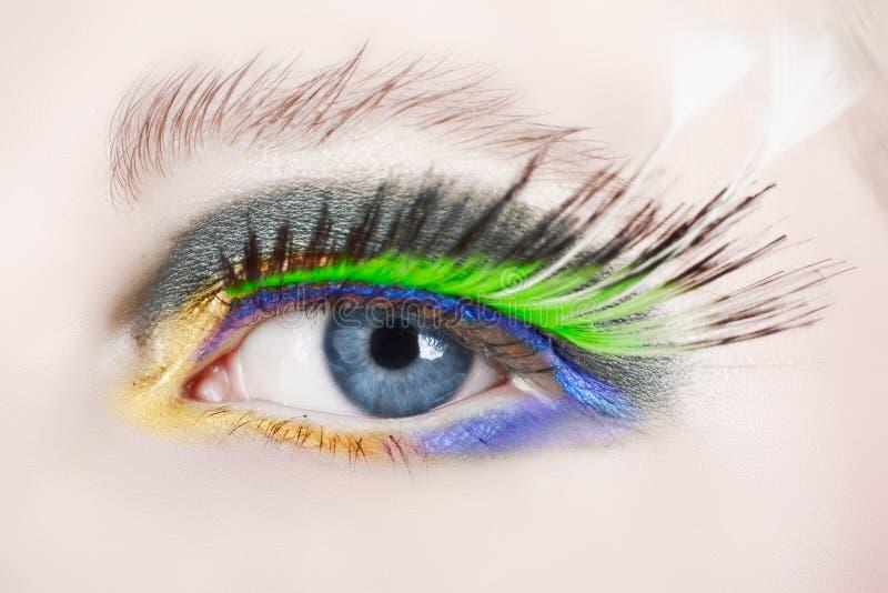 Macro eye with false lashes stock photography