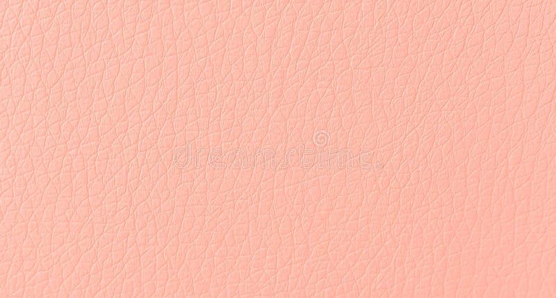 Macro fine della pelle di struttura di cuoio rosa-chiaro morbida moderna del modello su fondo fotografia stock libera da diritti