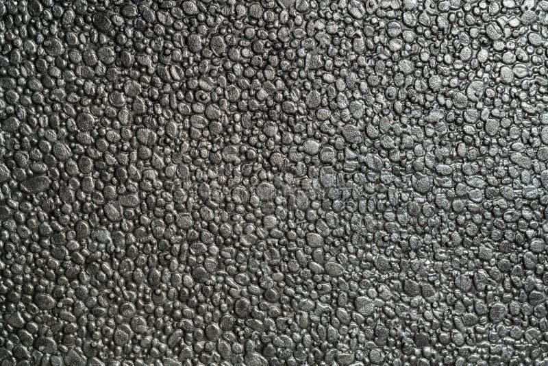 Macro fondo della struttura completa metallica nera del polistirene espanso immagini stock libere da diritti