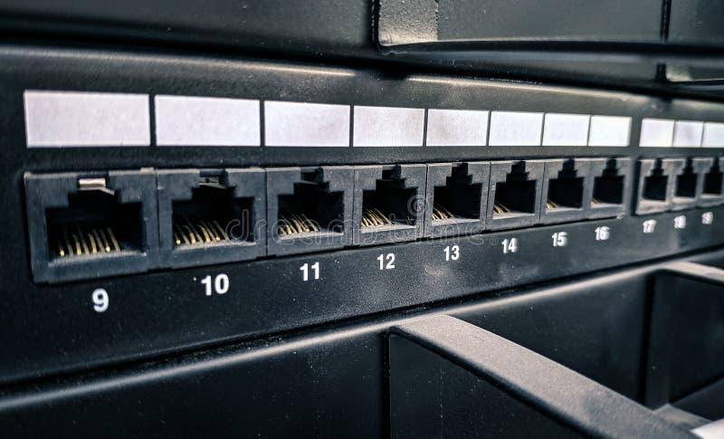 Macro foto dello scaffale di comunicazione, dati che fissano le prese fotografie stock