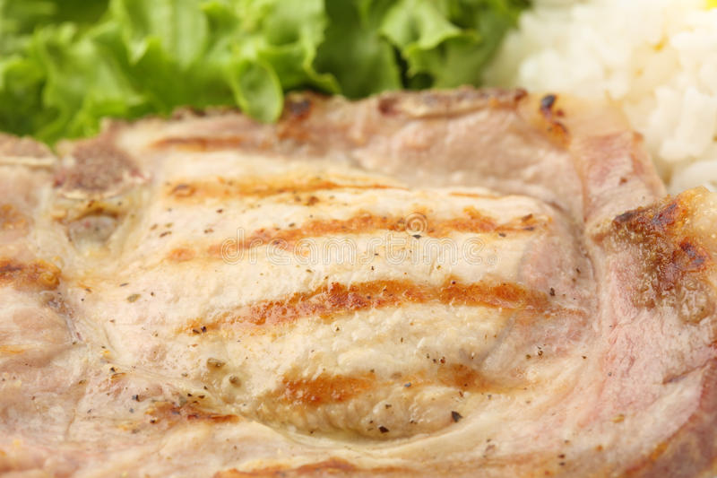 Macro of a fried pork chop-meat detail royalty free stock photography