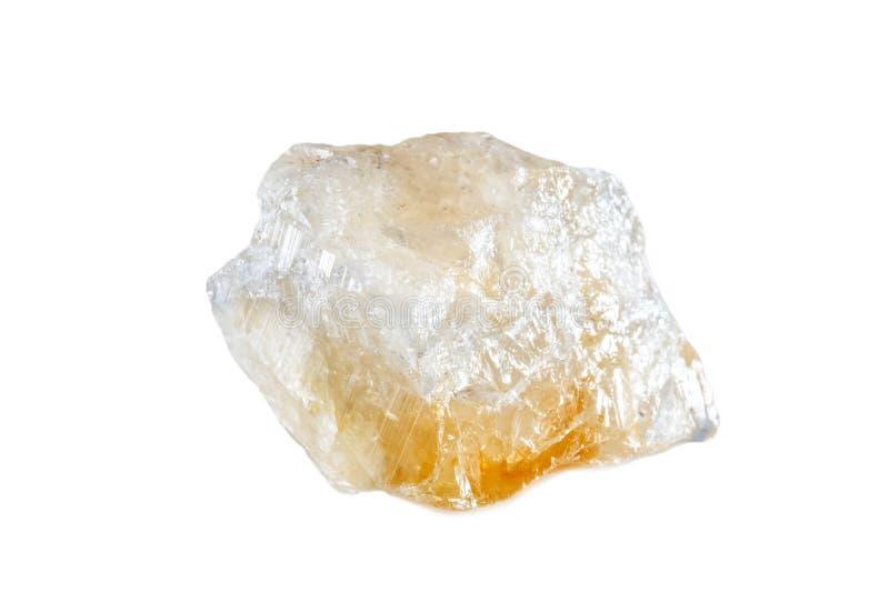 Macro fucilazione della pietra preziosa naturale Il minerale crudo è citrino brazil Oggetto isolato su una priorità bassa bianca immagini stock