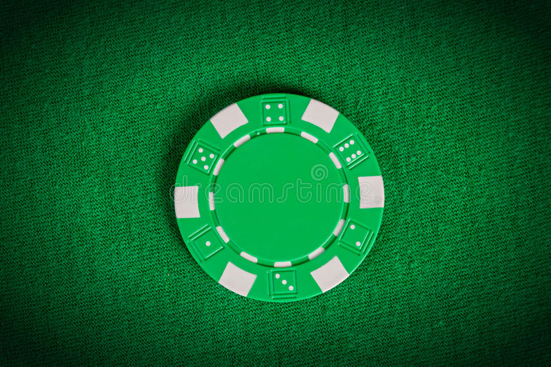 Macro green poker chip on table royalty free illustration