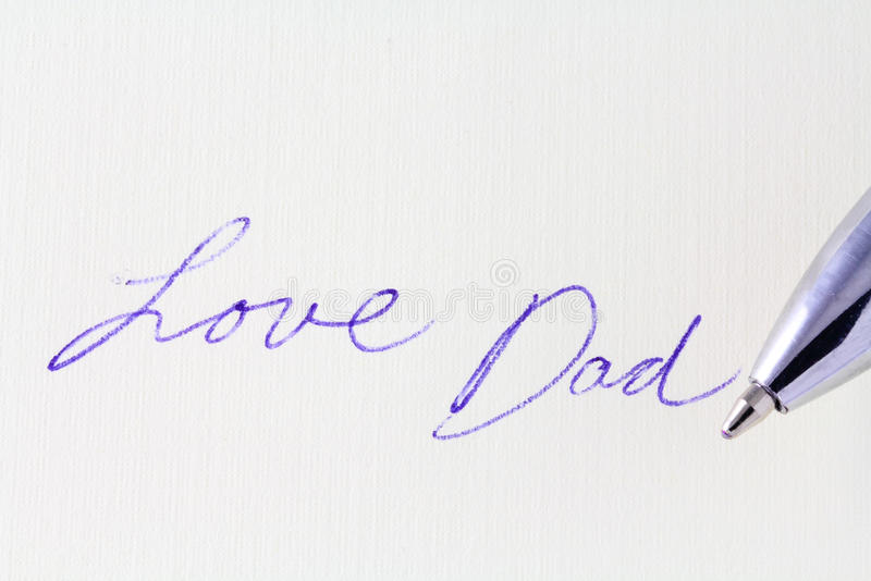 Love Dad. Macro of handwritten message Love Dad royalty free stock photos