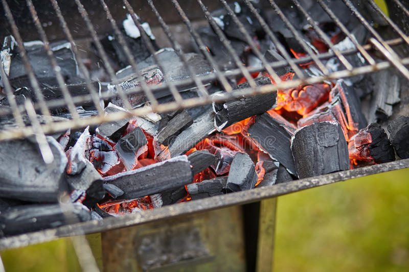 Macro image of a brazier with a grill. Horizontal macro image of a brazier with ruddy charcoal stock image
