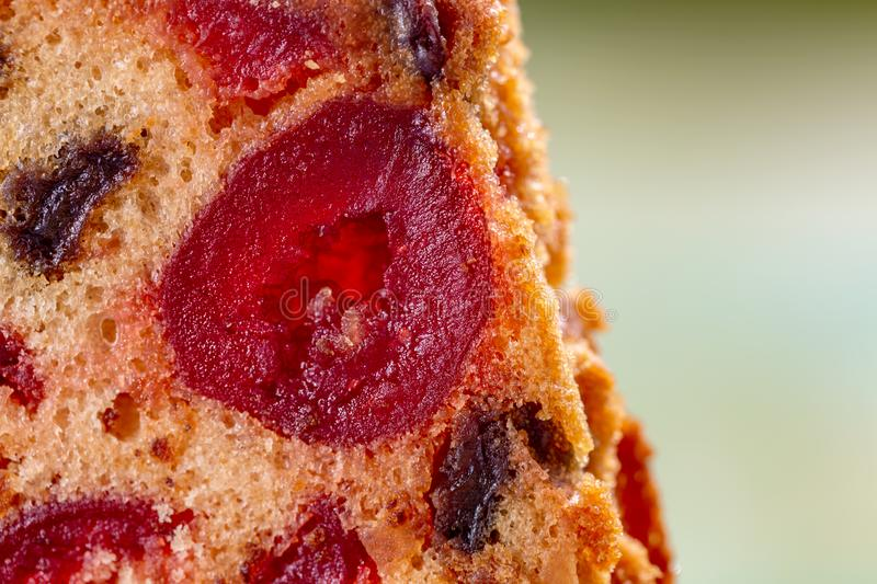 Macro image of a cake slice with fruits. Fruit cake with raisin and grapes. royalty free stock photography