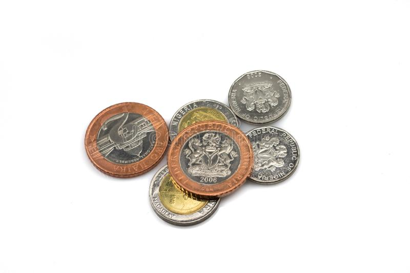 Nigerian coins, in a pile, isolated on a white background. A macro image of a collection of Nigerian coins isolated on a clean, white background.  Shot close up stock image