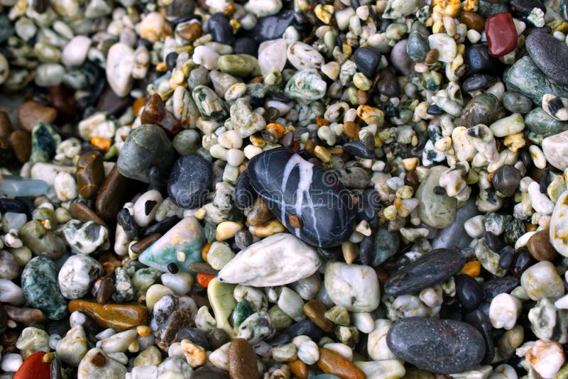 Colorful pebbles on a beach royalty free stock image