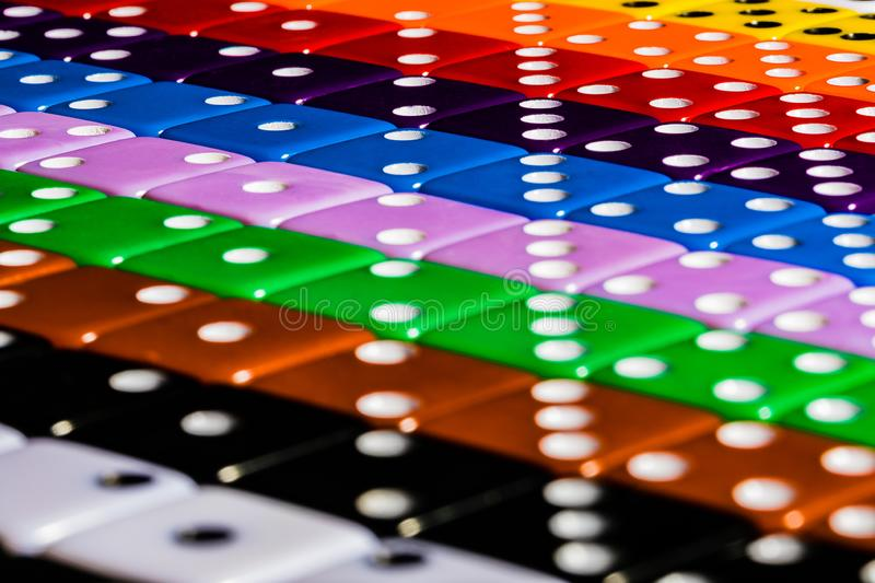 A Macro image of Diagonal rows of multicolored dice, lined in OCD fashion using the numbers to form perpendicular symmetry. stock photo