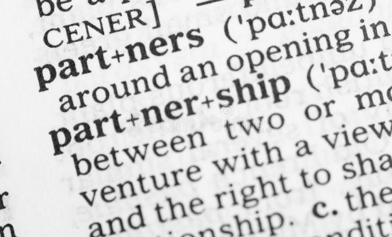 Macro image of dictionary definition of partnership royalty free stock photo