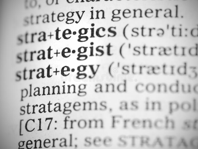 Macro image of dictionary definition of strategy stock images