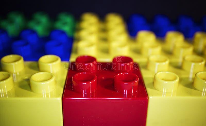 Macro image of Lego building blocks isolated on black background. stock photos