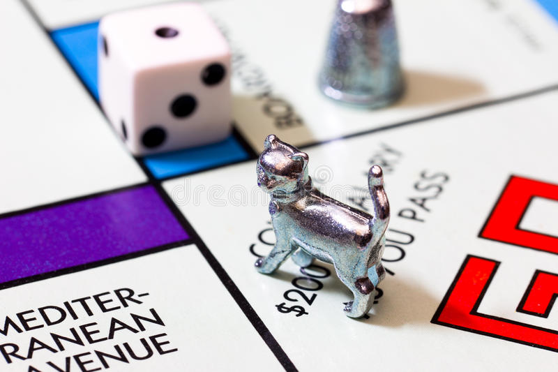 Macro image of Monopoly Game and Figures. LOS ANGELES, CA/USA - MAY 8, 2015: Monopoly board game macro image. Monopoly is a board game that originated in the royalty free stock photography