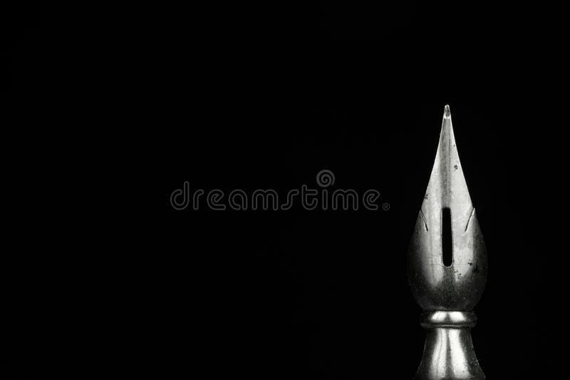 Macro image of a pen nib. Against a black background stock image