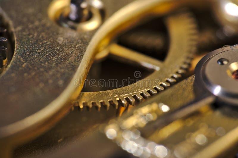 Macro internals di vecchi di un orologio immagine stock