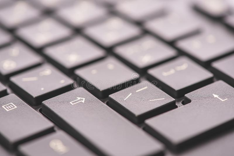 Macro keyboard keys, an angle view, soft background with copy space royalty free stock photography