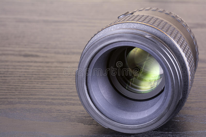Macro lens. For SLR digital camera on dark desk stock photo