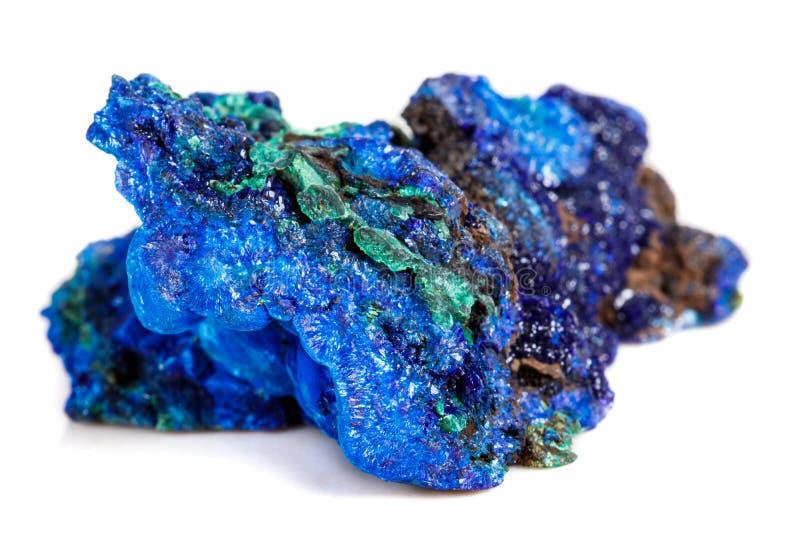 Macro malachite di pietra minerale con azzurrite su fondo bianco fotografia stock