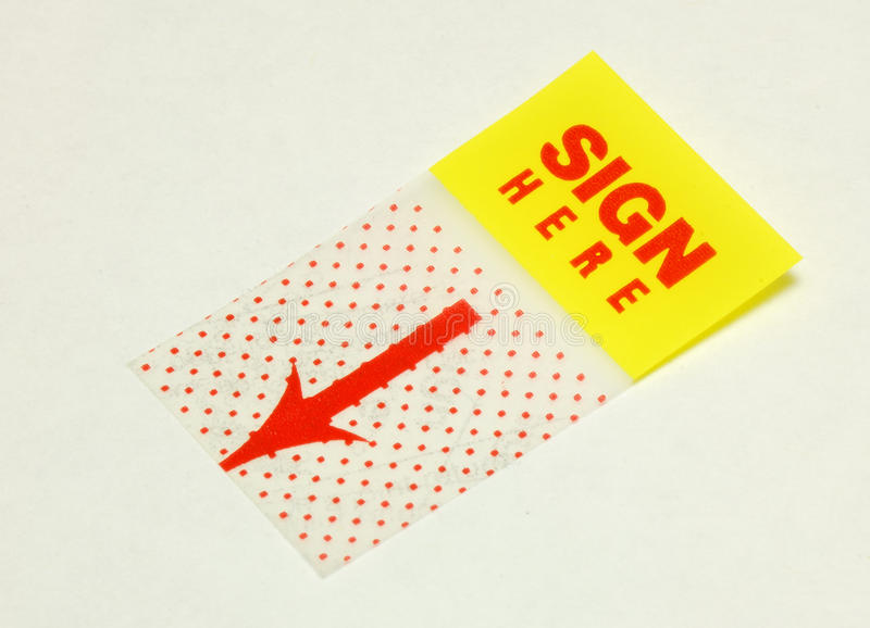 Macro mening van de teken hier sticker stock afbeelding