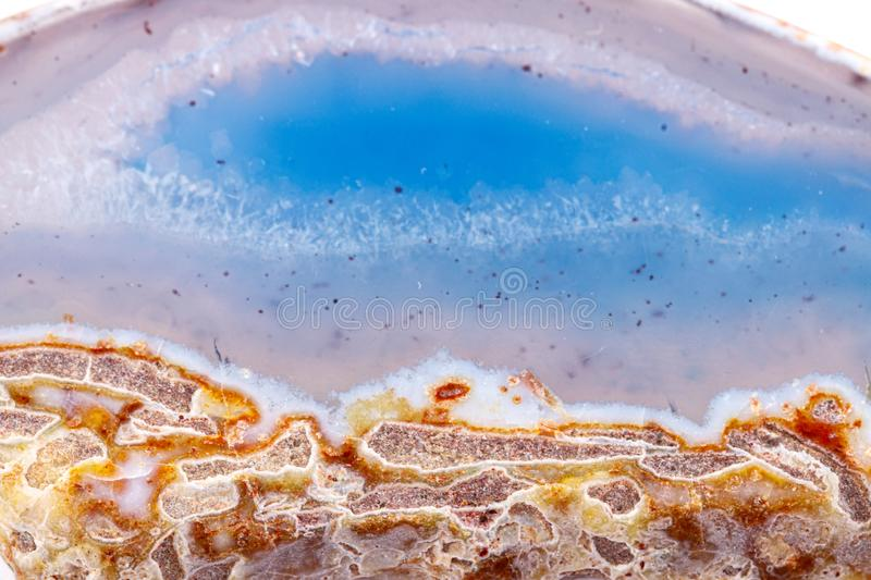 Macro mineral stone agate on a white background. Close up royalty free stock image