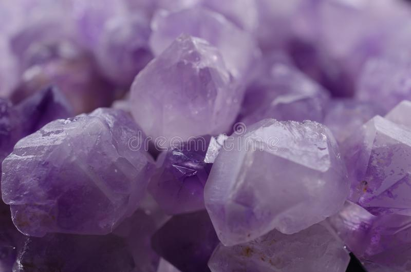 Multiple Mineral Amethyst Stones on a white background closeup stock photo