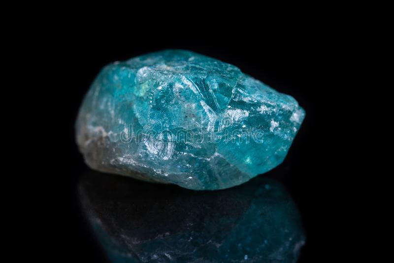 Macro mineral stone apatite on black background royalty free stock image