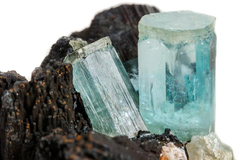 Macro mineral stone Aquamarine and black tourmaline, Schorl on a royalty free stock images
