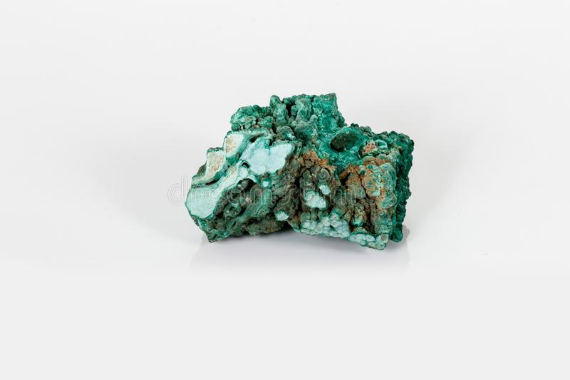 Macro mineral stone Malachite against white background. Close up royalty free stock image
