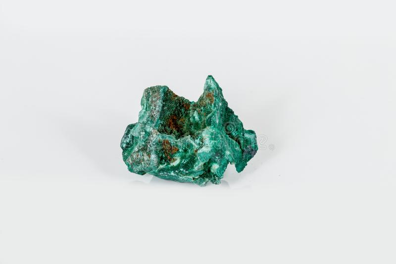 Macro mineral stone Malachite against white background. Close up stock photography