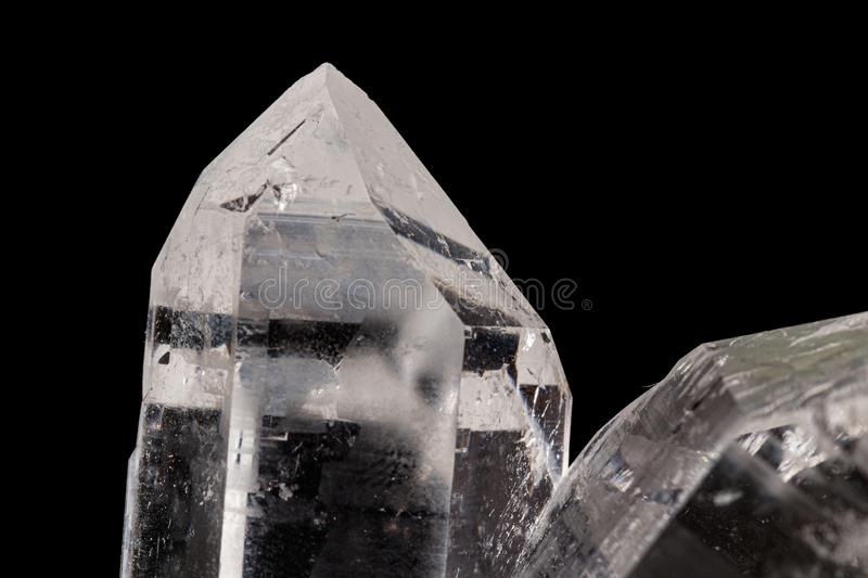 Macro mineral stone rhinestone, rock crystal on a black background. Close up royalty free stock photo