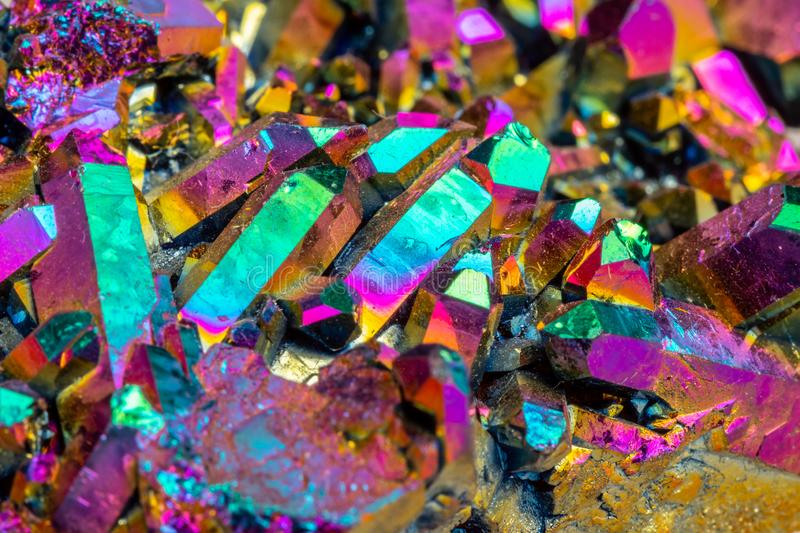 Macro mineral stone Titanium Quartz, Flame Aura Quartz on a whit stock photo