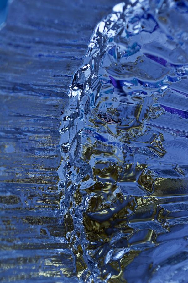 Macro modern art texture of bright abstract crystal glass reflecting brilliant blue color with a look of ice crystals or rock stock image