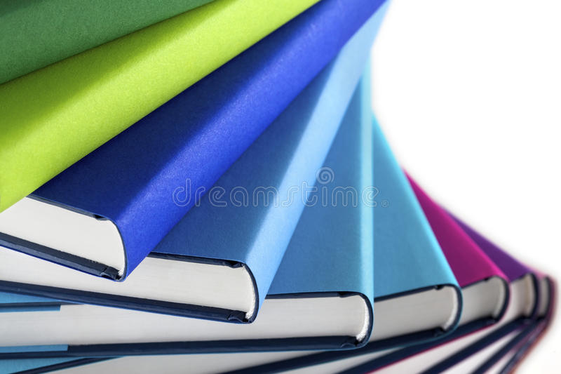 Macro of multi-colored stack of books stock image