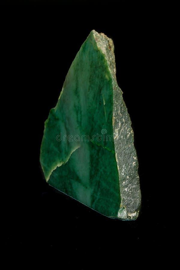 Macro nefrite della pietra minerale su fondo nero fotografia stock libera da diritti