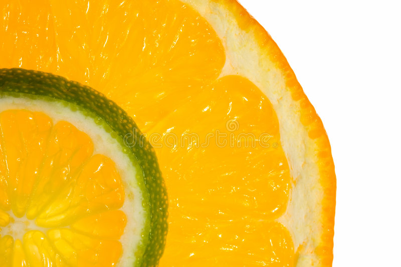 Macro of orange and lime slices stock photos