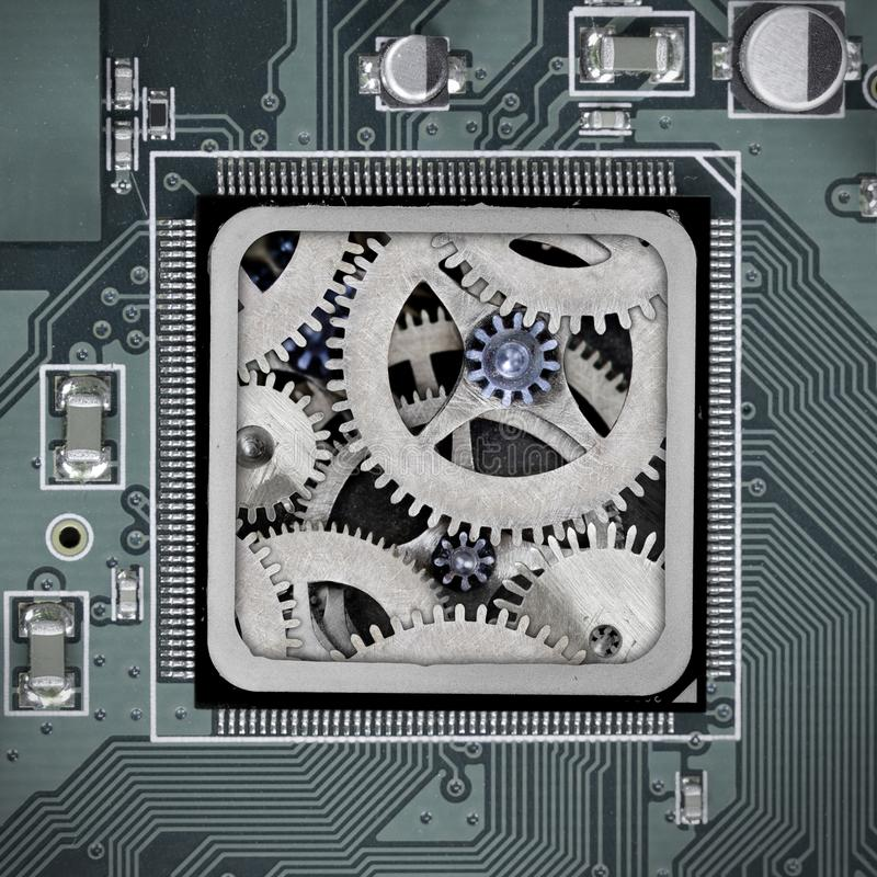 Circuitboard and Chip Concept. Macro photo of circuit board and chip with cog wheel mechanism; concept of technology connection royalty free stock photos