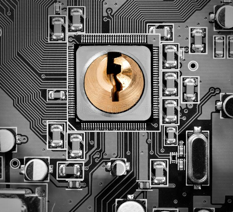 Circuitboard and Chip Concept. Macro photo of circuit board and chip with lock; concept of cyber security royalty free stock photo
