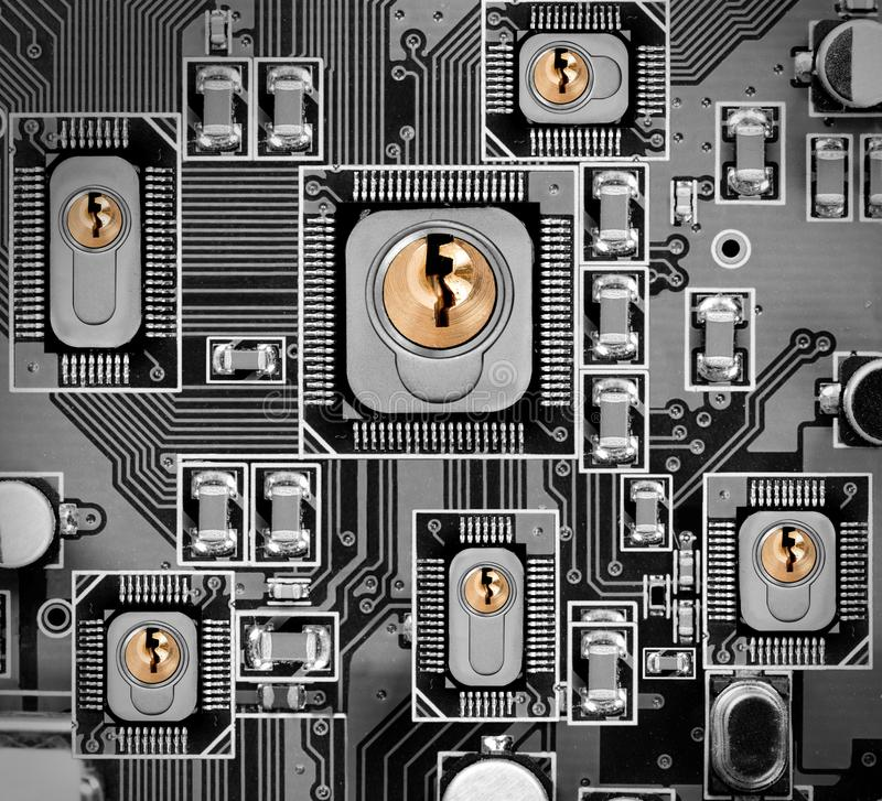 Circuitboard and Chip Concept. Macro photo of circuit board and chip with locks; concept of cyber and data security royalty free stock photos