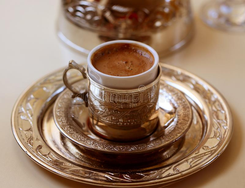 Macro photo of delicious Turkish coffee in a metal cup royalty free stock images