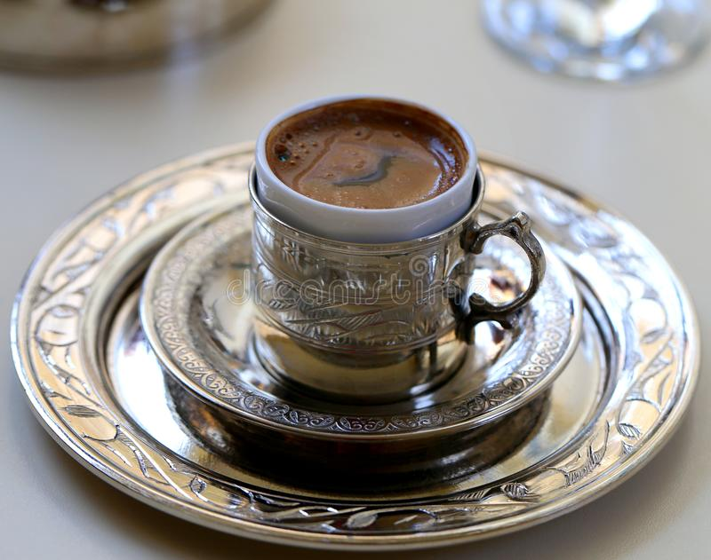 Macro photo of delicious Turkish coffee in a metal cup royalty free stock image