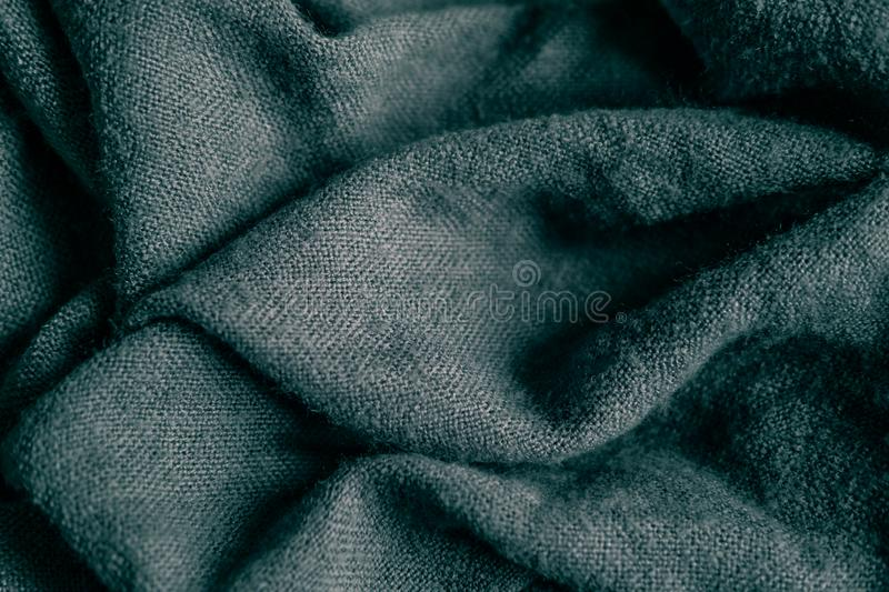Macro photo of fabric gray. Knitting, wool. Texture of fabric with folds for designers. Blank for banner atelier, mester. Macro photo of fabric gray. Knitting royalty free stock image