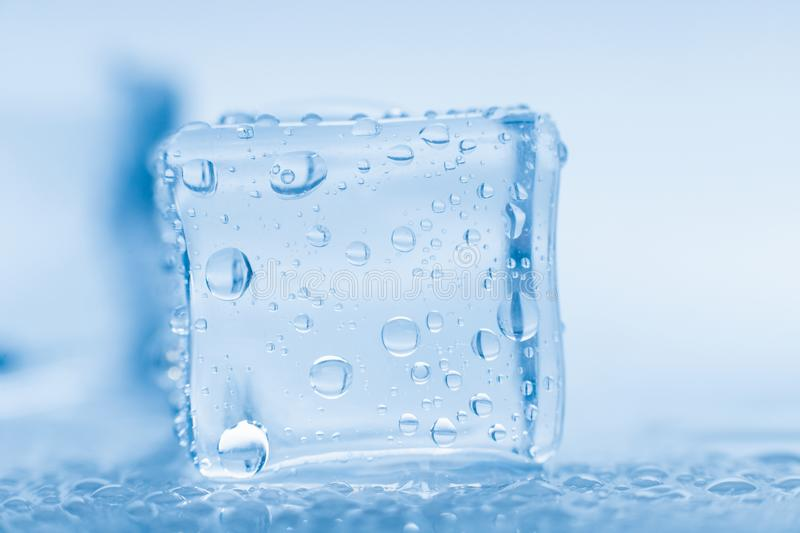 Macro photo ice cubes with drops water clean on blue background banner stock image