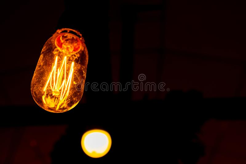 Macro photo of light bulb illuminated. Closeup view of individually illuminated filaments royalty free stock images