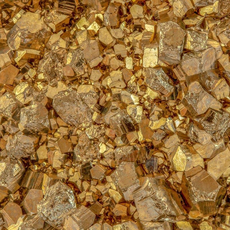 Macro photo of metallic golden color pyrite cubes stock photo