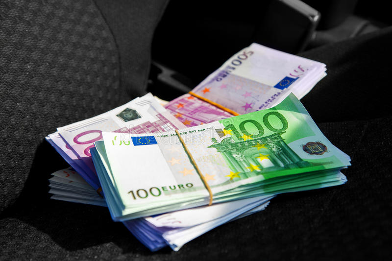 Macro photo of a pack of money EUR on a car seat. Inside photo stock image