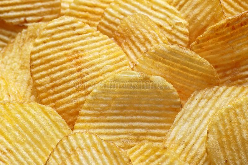 Macro photo of potato chips, embossed food background royalty free stock photography